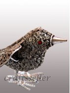 Filigree sitting bird