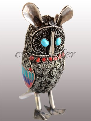 Filigree owl stone setting